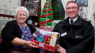 Greater Manchester Police Chief Constable gives a resident a hamper full of Christmas essentials