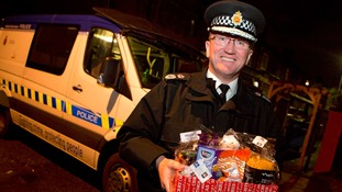 Greater Manchester Police Chief Ian Hopkins delivering hampers to elderly and vulnerable