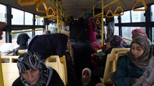 Evacuees board a bus to al-Rashideen.