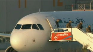 Security officers leaving the plane