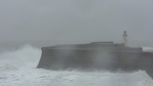 Whitehaven's harbour amidst Storm Barbara