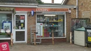 A village in the Fens has rallied round a shopkeeper who was the victim of an armed robbery.