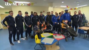 Football team visit children in hospital