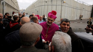 Many stopped to greet the Latin Patriarch of Jerusalem Pierbattista Pizzaballa as he made his way through an Israeli checkpoint.