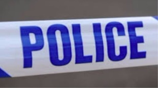 A car was damaged by a firearms discharge on Christmas Eve.