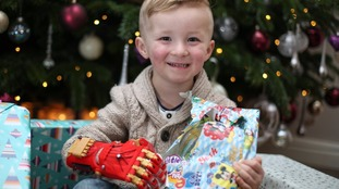 3D-printed bionic Iron Man hand helps four-year-old open Christmas presents for the first time