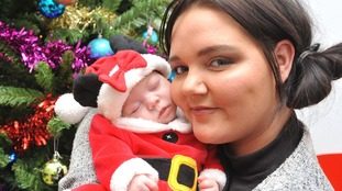Bar promoter who didn't know she was pregnant, brings baby home for Christmas