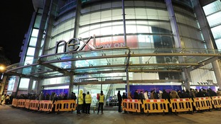 People queuing outside Next in the Arndale Centre, Manchester
