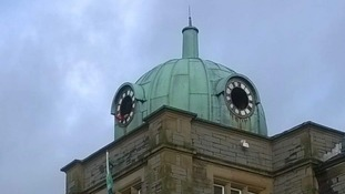 The Millom town square clock under restoration
