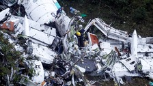 Rescue crew work at the plane wreckage