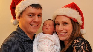 Jessica and Mike Powell with baby Evelyn Marie