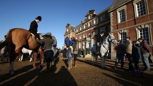 Members of the West Raynham hunt gather for the Boxing day hunt at Raynham Hall