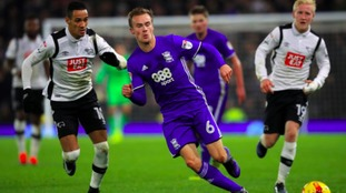 Derby County's Thomas Ince (left) and Birmingham City's Maikel Kieftenbeld in action