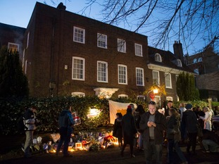 Mourners gather at George Michael's house in Highgate.