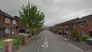 Woman questioned in St Helens murder investigation
