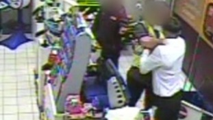 CCTV video footage shows a man grab supermarket security guard by the throat