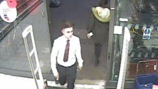 CCTV shows man grab supermarket guard by the throat.
