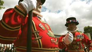Two Yeoman Warders - or Beefeaters who traditionally guard the Tower of London