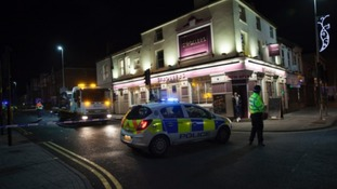 A 33-year-old man died after shots were fired into a stationary vehicle on the High Street.