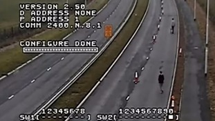 Police footage shows people moving 50 traffic cones on dual carriageway to reopen closed lane