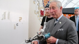 Prince Charles uses a 'tufting gun'