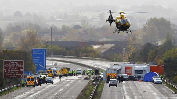 Emergency services at the scene on the M5 motorway close to Taunton in Somerset in November 2011