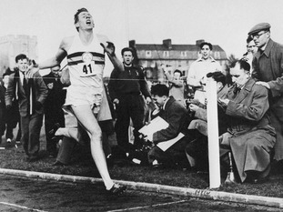 Roger Bannister breaks the four-minute mile in a time of three minutes 59.4 seconds in 1954.