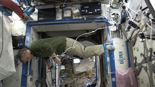 One of the ISS crew is spotted hovering in the space station.