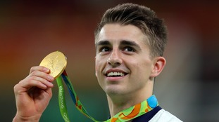 Max Whitlock celebrates winning an Olympic gold medal following victory on the floor apparatus in August.
