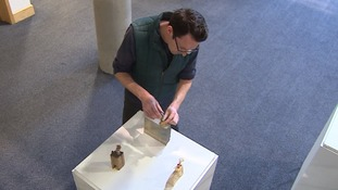 David Kefford putting some of his pocket sculptures on display in Cambridge.
