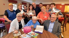 Nell Jinks with all her family and lots of cards from the Queen
