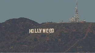 Hippy New Year! Hollywood sign altered overnight in apparent homage to new marijuana law