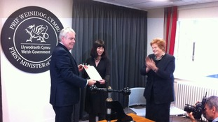 First Minister Carwyn Jones hands the sealed Welsh Act to National Assembly Clerk Claire Clancy