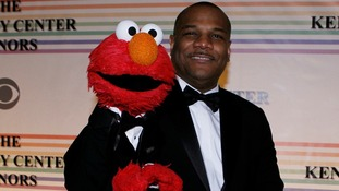 Elmo and Kevin Clash pose for photographers on the red carpet at the Kennedy Center in Washington