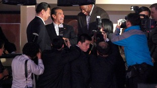 Xi Jinping meets Magic Johnson at a NBA basketball game in Los Angeles in February 2012