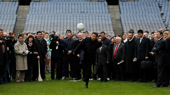 Xi Jinping kicks a football during a visit to Croke Park in Dublin.