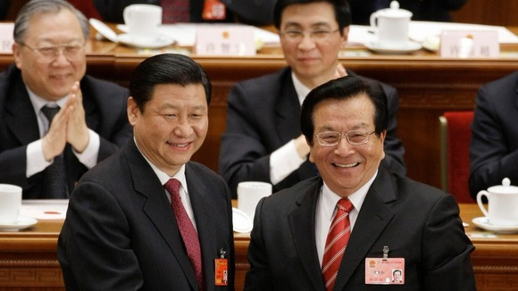 Newly elected Vice-President Xi shakes hands with his predecessor Zeng Qinghong in 2008.