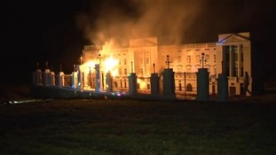The model of Buckingham Palace burns