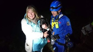 Reunited - the owner with her dog after a dangerous rescue.