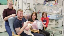 Rachel Davison and Paul O'Rourke with new arrivals Poppy, Lily and Hollie