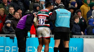 Manu Tuilagi is treated for an injury during the Aviva Premiership match against Saracens.