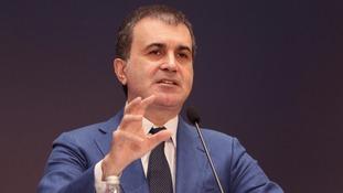 Omer Celik, addressing a news conference last year.