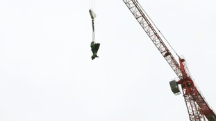 The man is winched with a member of the West Midlands Ambulance Service