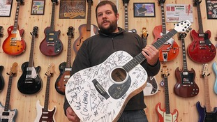 The money raised from the 'stars guitar' will support hospices in the North West
