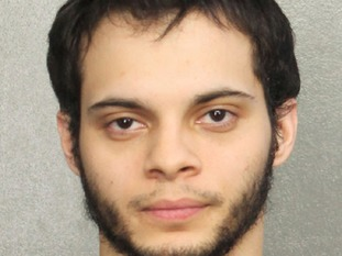 Suspect Esteban Santiago pictured at Broward Sheriff's Office in Florida after his arrest.