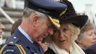 Camilla, Duchess of Cornwall, speaks to her husband Britain's Prince Charles during an event to commemorate Armistice Day in Auckland