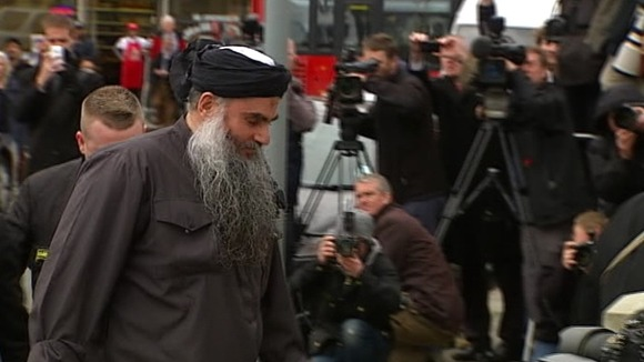 Abu Qatada arrives back in north London.