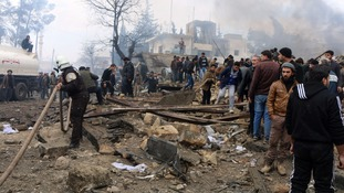 Rescue workers at the scene of the blast.