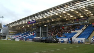 Peterborough supporters watching the FA Cup tie with Chelsea on a big screen at the ABAX Stadium