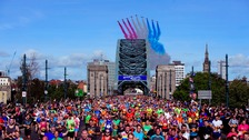 The Red Arrows fly over the Tyne Bridge during the Great North Run in Newcastle.